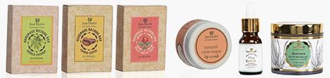 View Just Herbs bathing bar trio, body butter, elixir and facial massage gel.