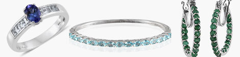 Tanzanite ring, apatite bangle and emerald inside out hoop earrings.