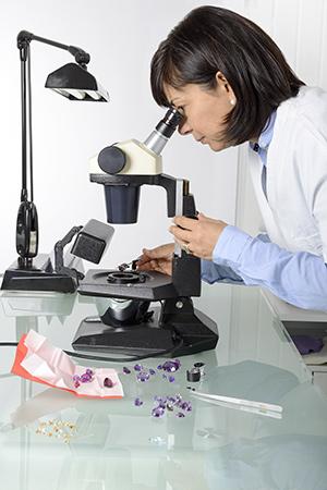 Gemologist analyzing gemstones