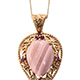 Australian pink opal pendant in a setting of yellow gold.