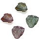 Four Bekily color change garnet rough cut gemstone pieces.