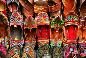 Indian marketplace selling sandals.