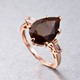 Chocolate sapphire ring in a setting of rose gold.
