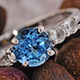 Electric blue topaz promise ring for women.