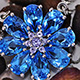 Electric blue topaz floral pendant with chain.