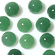 Round-shaped cabochon emerald quartz stones.