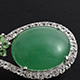 Elegant pendant with an oval-shaped cabochon of emerald quartz.