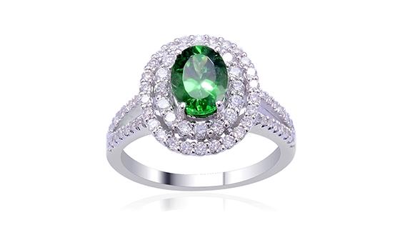 Tsavorite garnet halo style ring.