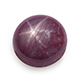 Round cabochon Kenyan star ruby displaying asterism, or the star effect.