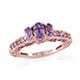 Mauve sapphire ring with decorated band in rose gold finish.