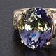 Tanzanian Green Zoisite solitaire with side stone ring.