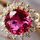 Ouro Fino rubellite halo ring in yellow gold finish.