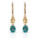 Paraiba topaz earrings in yellow gold finish.