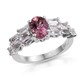 Pink tourmaline side stone ring in sterling silver.