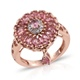 Pink tourmaline cluster ring with a dangling stone in rose gold finish.