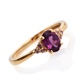 Purple garnet ring in yellow gold finish.