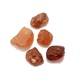 Four rough hessonite garnet pieces.