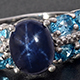 Ring with oval-shaped cabochon of Thai blue star sapphire.