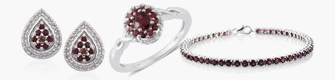 Anthill garnet earrings, ring and bracelet in sterling silver.