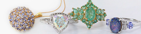 Collection of fashion jewelry including a necklace and rings.