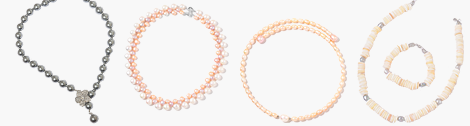 Three real multi-strand pearl necklaces with unique designs.