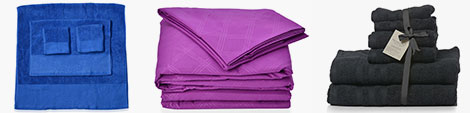 Find blue cotton towel, purple bedsheet with pillow covers and black set of towels.