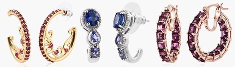 Two pairs of hoop earrings for women.