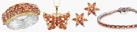 Peruse orange sapphire cluster ring, butterfly pendant, floral earrings and tennis bracelet.