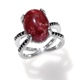 Split ring with oval-shaped cabochon of Norwegian thulite.